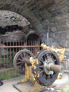Metal wheel with fire around rim at Scranton Iron Furnaces event