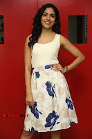Actress Ritu Varma Stills in White Floral Short Dress at Kesava Movie Success Meet .COM 0158.JPG