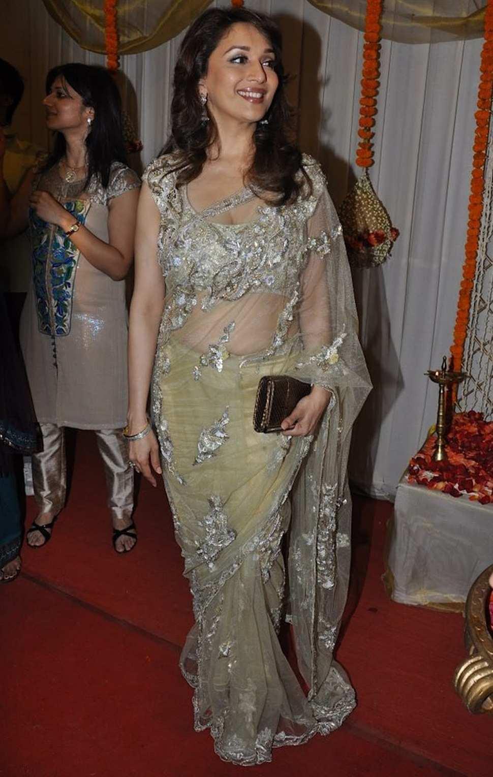 Glamours Hindi Actress Madhuri Dixit Latest Hot Photos In Yellow Saree