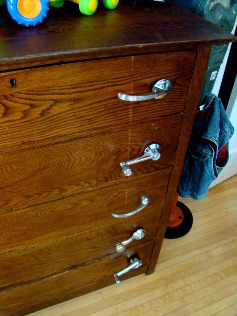 old car door handles and window handles as dresser drawer pulls