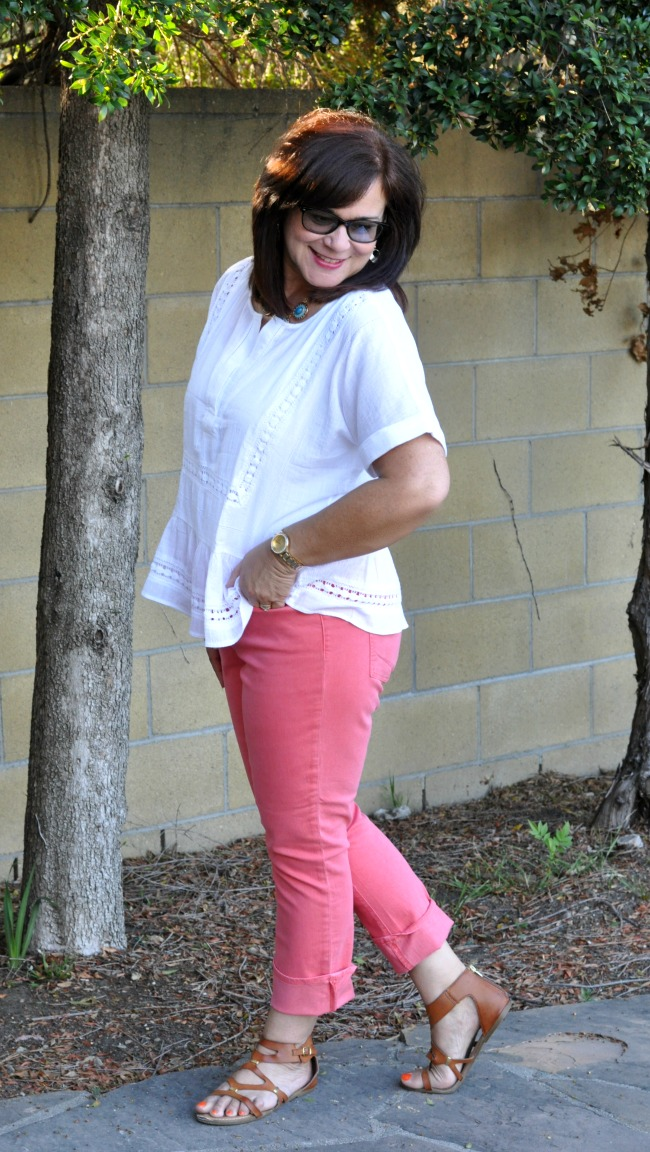 white linen top and coral ankle jeans