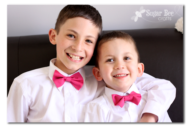 boys in pink bow ties
