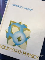 Solid State Physics,  by Ashcroft and Mermin, superimposed on Intermediate Physics for Medicine and Biology.