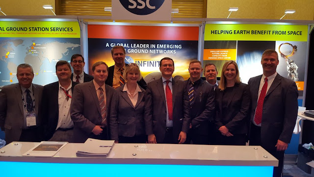 Several members of Team SSC in front of their booth at the Space Symposium. Photo Credit: SSC