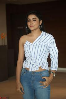 Avanthika Mishra in One Shoulder Crop Top and Denim Jeggings at At Vaishakham Movie Press Meet ~ Exclusive