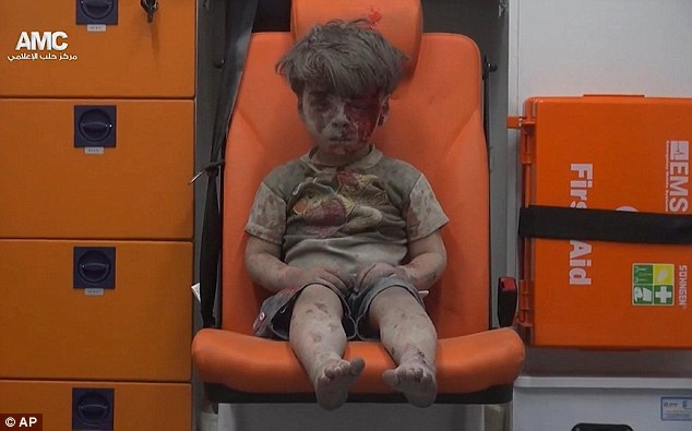 Father of famous wounded Syrian boy exposes how mainstream media demonized situation in Syria