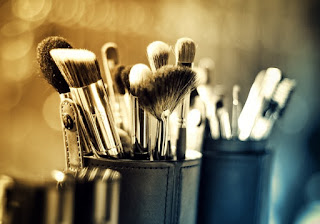 makeup brushes in black holder.jpeg