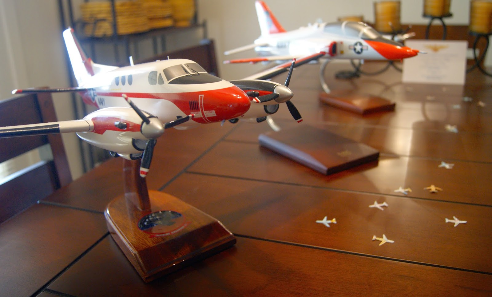 My favorite place to purchase them is Squadron Toys because you can get the squadron logo on the base. This makes it all the more special for the aviator!