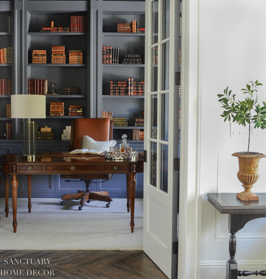 home library with books in gray bookcases