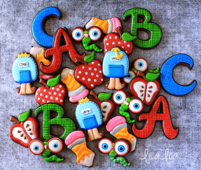 Brightly decorated back to school sugar cookies - backpacks cookies, bookworm cookies,  pencil cookies, apple cookies and letter cookies