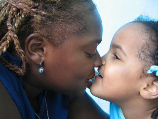 Image: Mother and daughter share a kiss, by Chris Darling, on Flickr