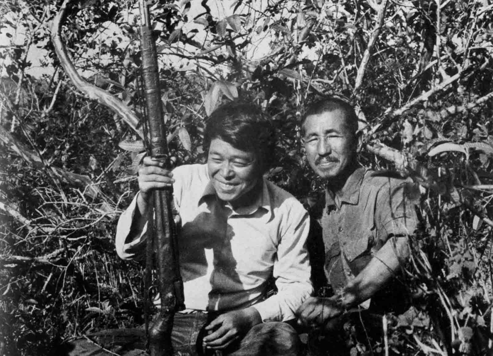 Norio Suzuki poses with Onoda and his rifle after finding him in the jungles of Lubang Island. February, 1974.
