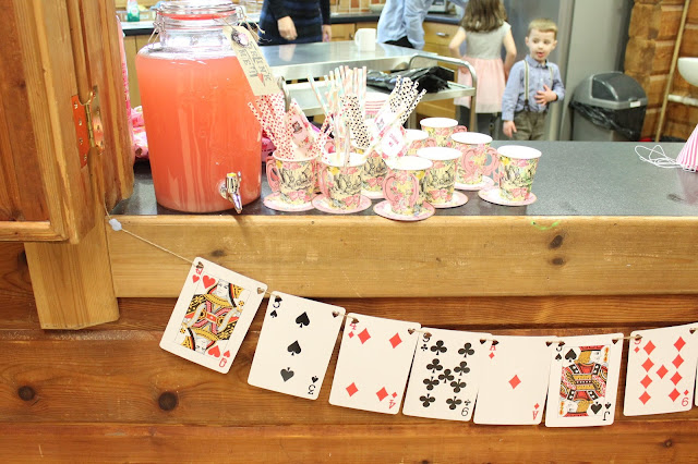 mad hatter themed party giant card bunting teacups and drinks dispenser