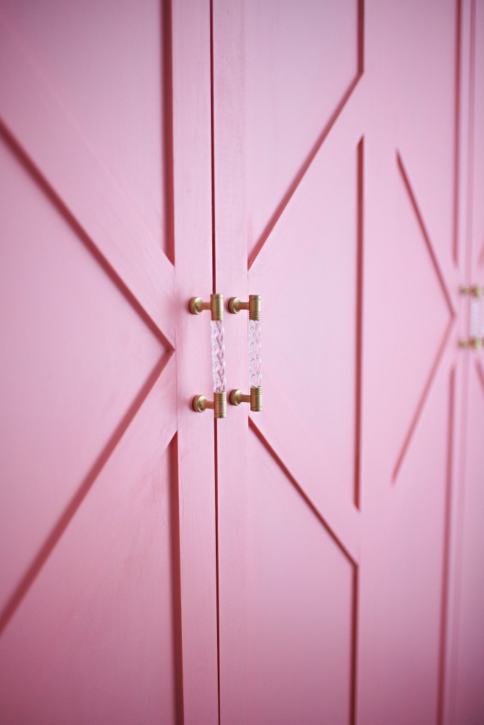 Update your bifold hollow core closet doors with some bright paint and lattice. An easy and inexpensive DIY weekend project. The paint color featured in Sherwin-Williams' Dishy Coral which is a perfect peachy/coral/pink color.
