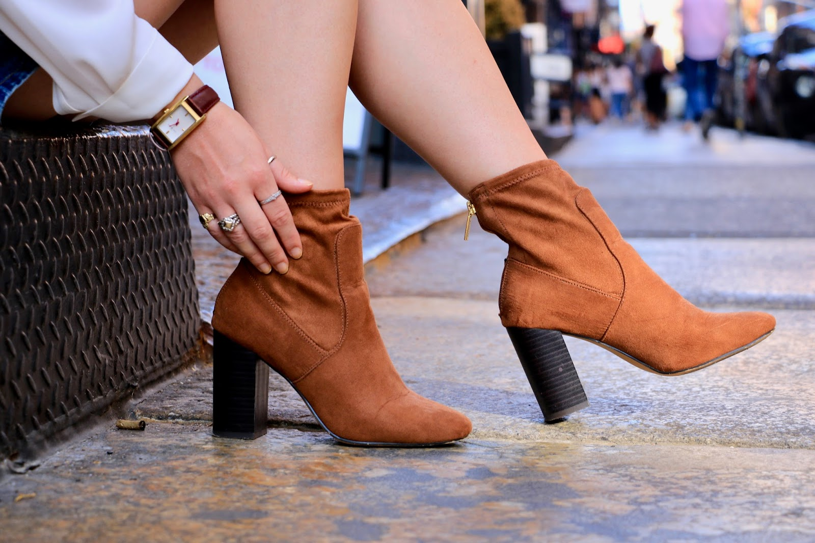 Fashion blogger Kathleen Harper showing how to wear sock booties