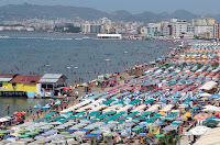 People rush to the beach during heat waves in the Mediterranean region, which will get more extreme as the globe warms. (Credit: Getty Images)  Click to enlarge.