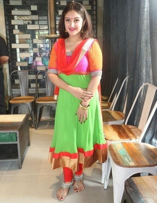 Sridevi              Vijaykumar In Green Dress at Ulavacharu Restaurant