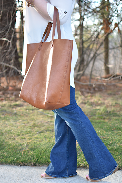 old navy flare denim bp from nordstrom hat lush tunic white madewell transport tote dolce vita booties in brown kendra scott elle earrings seventies look bell bottoms flare jeans spring trend bourbon and boweties alex and ani bracelets
