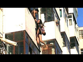women jumps from top floor video