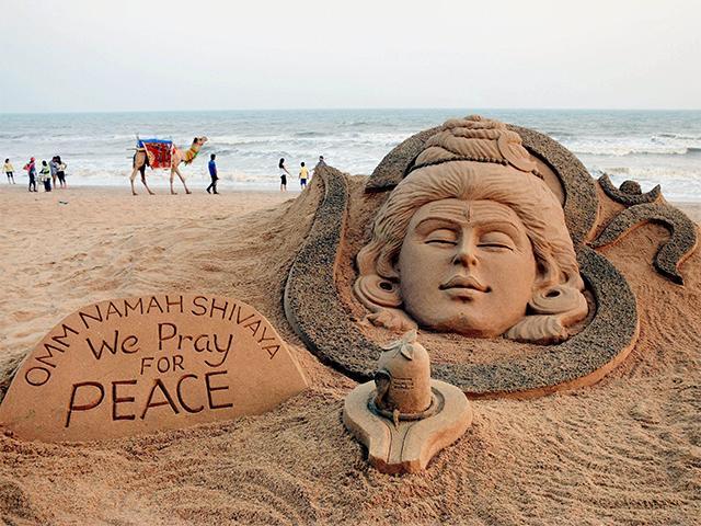 Lord Shiva on the eve of Maha Shivratri at Puri beach.