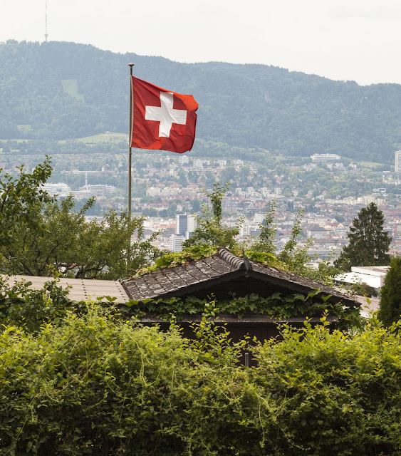 Places to Visit in Zurich in One Day with a ZVV Day Pass: Swiss Flag at a community garden