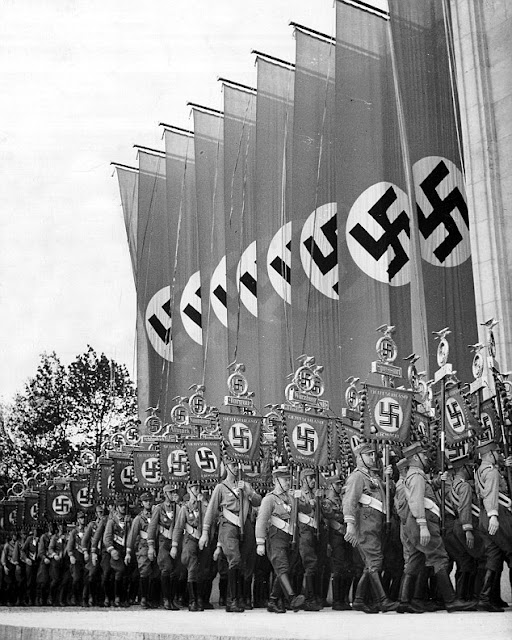 Nazi parade, probably during the Nuremberg Rally of 1934, from Triumph of the Will by Leni Reifenstahl (1935)