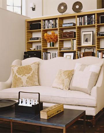 Belgian sofa and bookshelves in Belgian style Manhattan apartment of Ina Garten