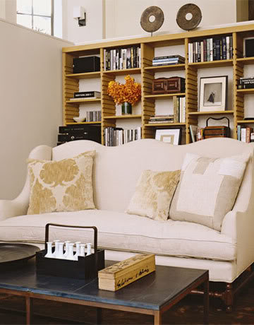 Belgian sofa and bookshelves in Belgian style Manhattan apartment of Ina Garten