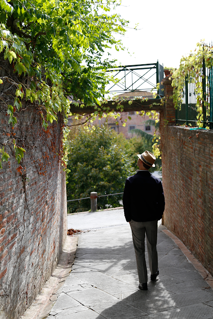 Paul Walking down Cobbled Street in San Miniato, Tuscany, Italy