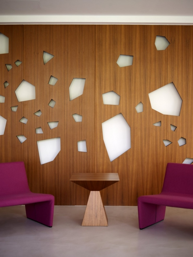 Wooden wall and purple chairs