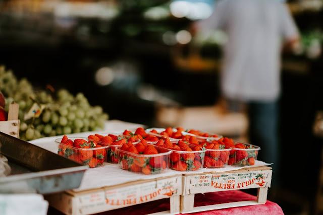 Photo by Annie Spratt on Unsplash- strawberry punnets in Venice