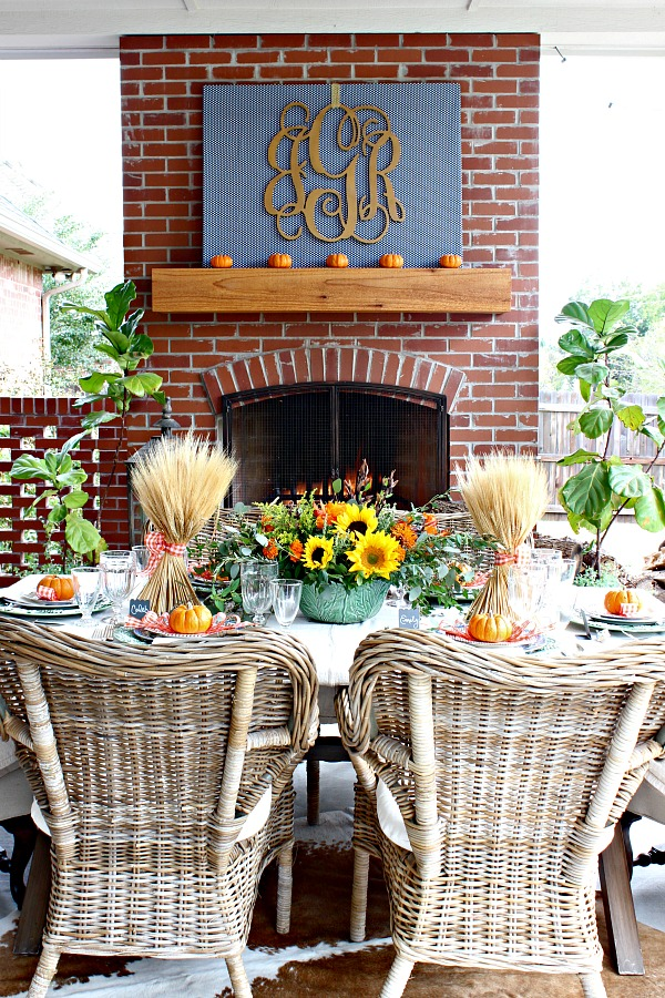 outdoor living area, dining room, brick outdoor  fireplace, thanksgiving table, ikea byholma chair,