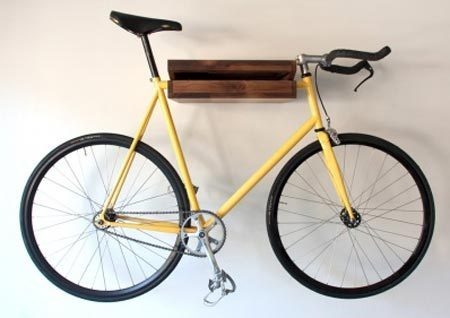 This cute little decorative bicycle is a perfect wall accent with a bright yellow frame