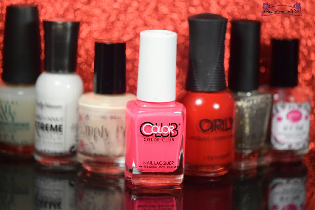 O.P.I Original Nail Envy, Sally Hansen Xtreme Wear White On, Bliss Kiss Simply Peel Latex Barrier, Color Club Jackie Oh!, Orly Haute Red, ILNP Fame, Glisten & Glow HK Girl Fast Drying Top Coat