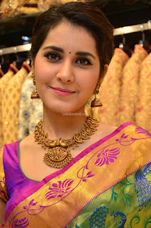 Raashi Khanna in colorful Saree looks stunning at inauguration of South India Shopping Mall at Madinaguda ~  Exclusive Celebrities Galleries 008