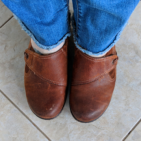 image of the bottoms of my legs and feet; I'm wearing a pair of blue jeans and brown slip-on shoes, with scuffed tops