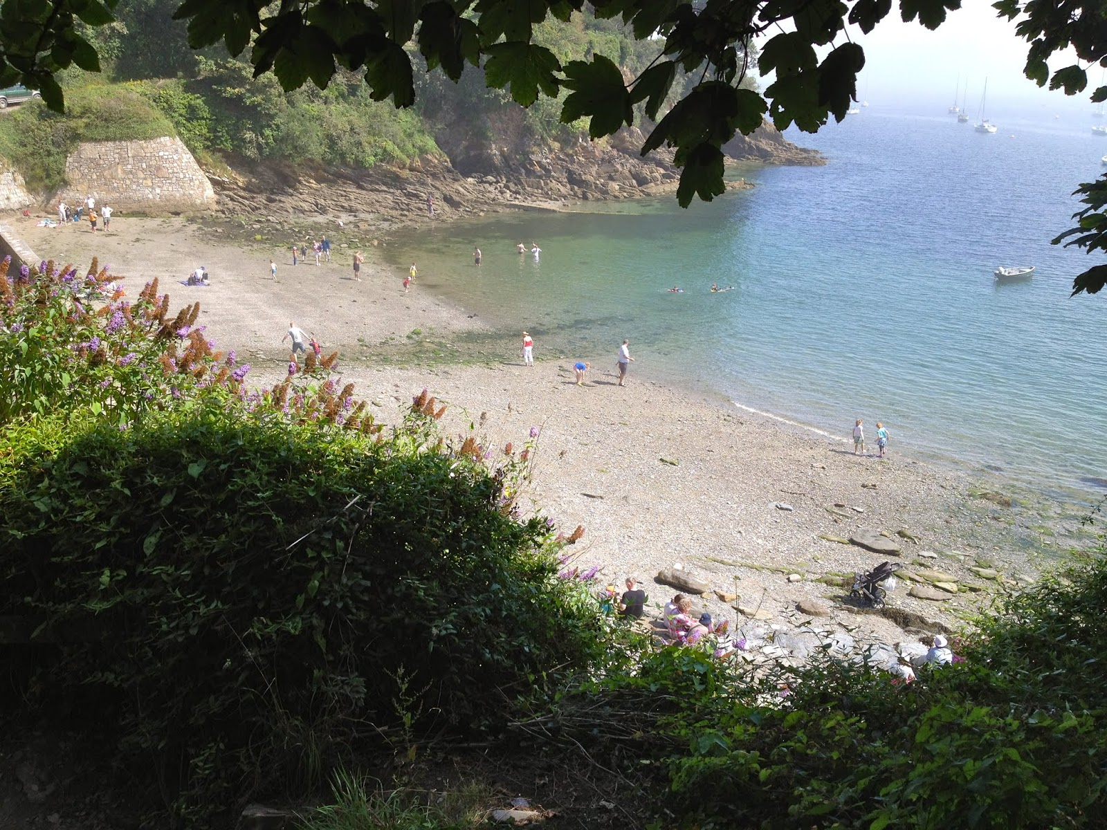 Children playing on the shore of the Helford River, Cornwall