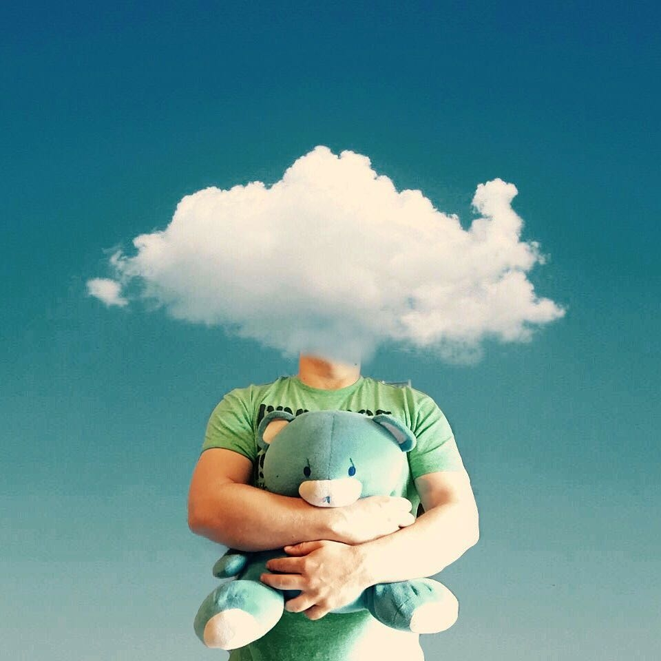 12-Head-in-the-clouds-Marcus-Einspannier-Surreal-Digital-Photo-Manipulation-using-Clouds-www-designstack-co