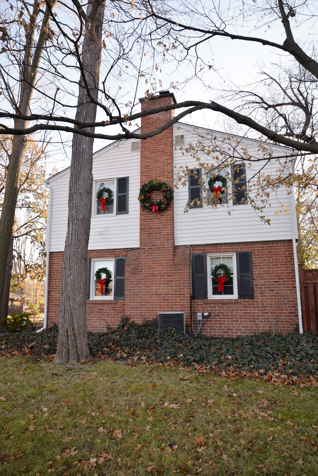 white house black shutters christmas wreaths, wreath on chimney