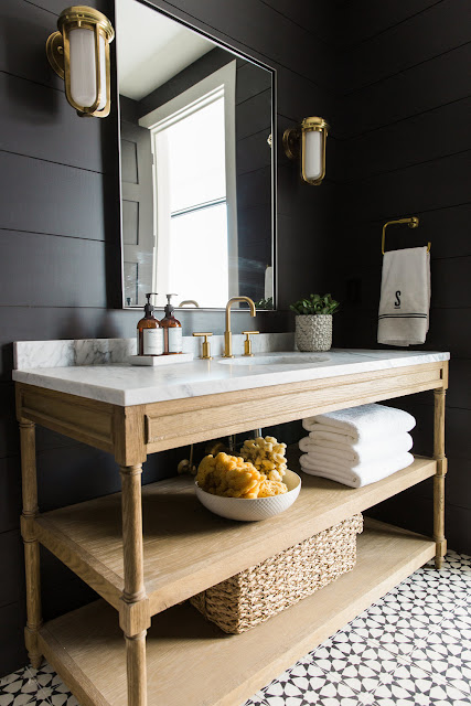 Shiplap walls painted black in bathroom with modern farmhouse style black walls