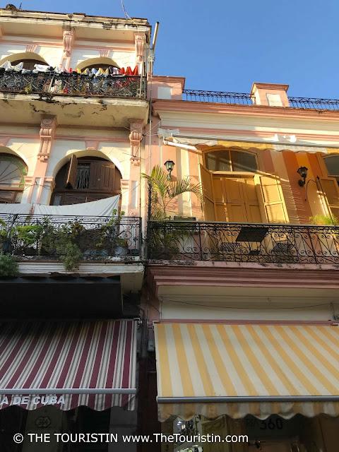 calle obispo facade shop fronts havana vieja the touristin cuba