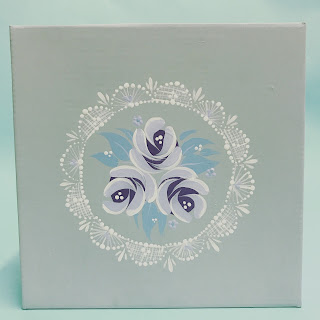 Hand painted gift box decorated with folk art style roses and a lace pattern