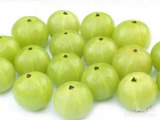 Indian gooseberry called aamla kept on plate  , How To Turn White Hairs To Black Naturally Irrespective Of Age- Buddi