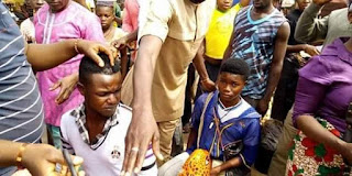 OUTRAGE AS YOUTHS STORM MARKET IN GBOKO, BENUE AND FORCEFULLY SHAVED YOUNG MEN WITH 'LONG' AND AFRO HAIR