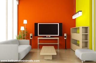 Perpaduan warna kuning dan orange cat rumah minimalis bagian dalam