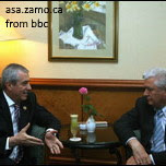 tariceanu talking to voronin at a table