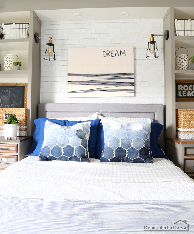 blue and grey decor in boy room