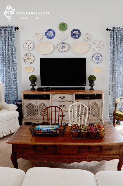 Decorating around TV with plates