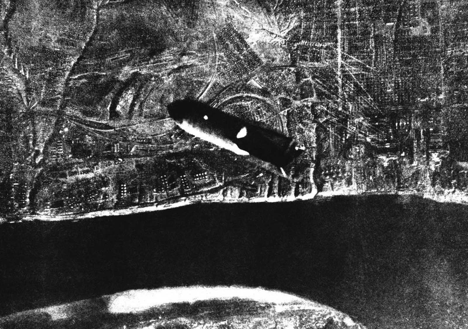 This picture, received by the Associated Press on September 25, 1942 through a neutral source, shows a bomb falling after it has just left the plane on its descent to Stalingrad below.