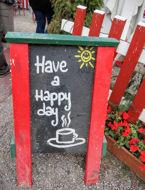 Have a Happy Day sign outside Regatta in Helsinki, Finland